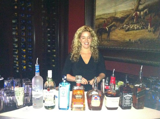 , : Bartender Amber serving the best Manhattan