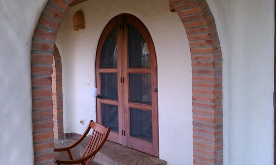 Pelican Eyes Resort and Spa: Porch and front door of Habitacione
