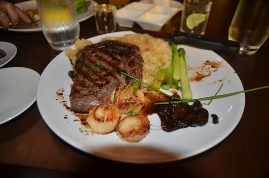 Cranston, RI: Our own surf and turf--my rib eye and two of my wife's scallops
