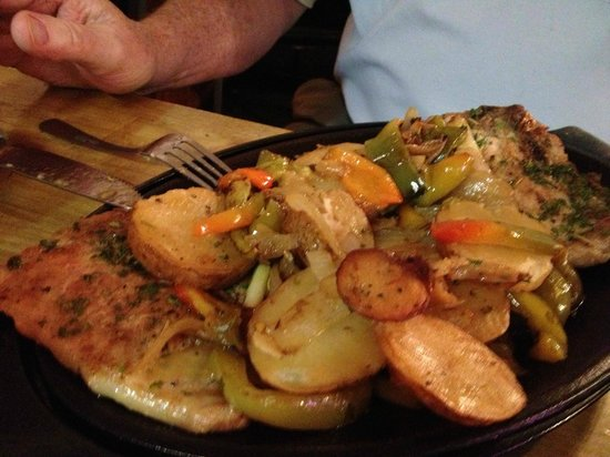 Bordentown, NJ: Pan seared pork chop smothered with potatoes, peppers and onions