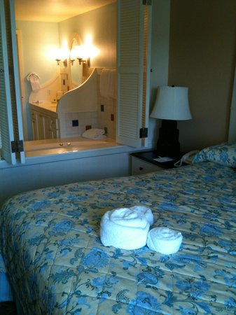 Disney's BoardWalk Villas: Mickey towel design on the bed and view of tub and sink