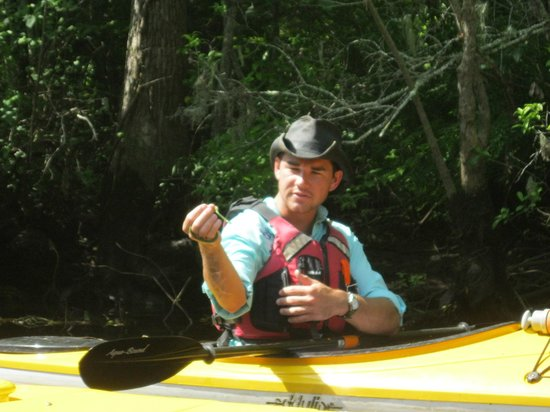 Pawleys Island, SC: Our guide, Cameron, and a rough green snake