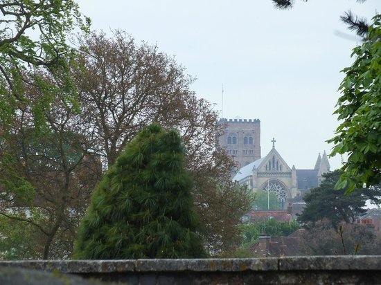 Saint Albans, UK: looking from corner of waffle House ,across St Michael's bridge into the park and Abbey