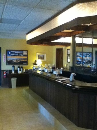 Oswego, NY: Breakfast bar setup - today including pastries, oatmeal, juices, fresh fruit, and snack bars