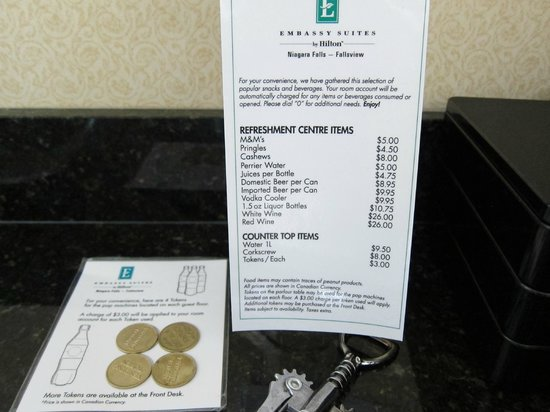 Embassy Suites by Hilton Niagara Falls Fallsview Hotel: Price list of mini-fridge contents. Those were small bottles & cans