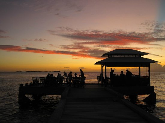 Wakatobi Dive Resort: Sunset over the bar at the end of the resort pier.
