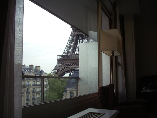 Pullman Paris Tour Eiffel: View from bed against window, Eiffel Tower View room 719