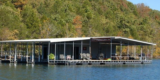 Beaver Lakefront Cabins: The boat dock and fishing room as seen from Beaver Lake.