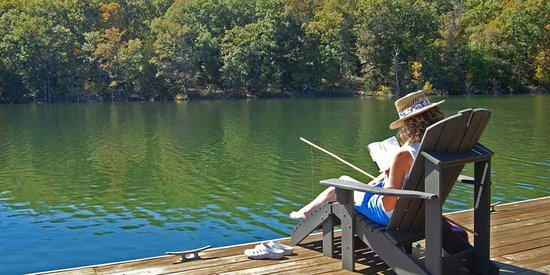 Beaver Lakefront Cabins: Relaxing on our sundeck while fishing.