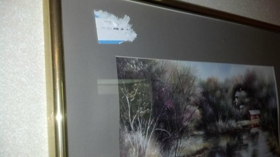 Des Moines, WA: Auction Sticker from when they bought this beautiful art. Really? Can't scrape that off?