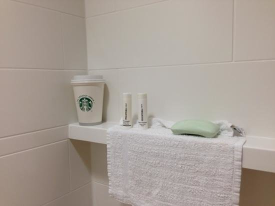 Westampton, NJ: shower has shelf for your coffee.