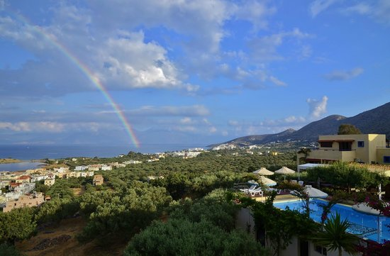Elounda Heights Apartments and Studios: A rainbow over the heights after a rare shower.