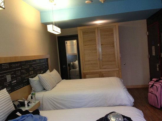 TRYP by Wyndham Times Square South: Built-in offers closet space, but makes a great suitcase rack area