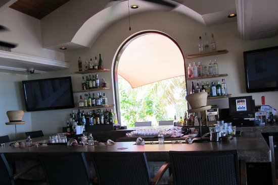West End Village, Anguilla : Outside bar seating (n the arch way) - where you can walk up in swim suits...
