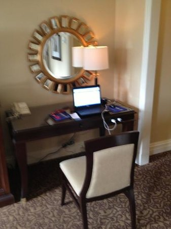Omni William Penn Hotel: Desk; note the white cords show the desk outlet but also outlet on wall to right