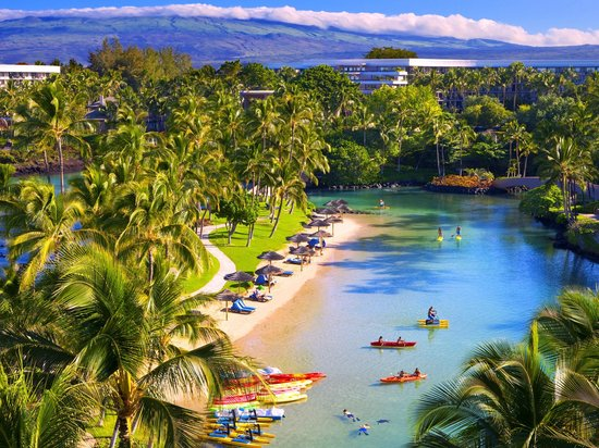 Hilton Waikoloa Village: Protected ocean fed lagoon beach features calm snorkeling with tropical fish and turtles.