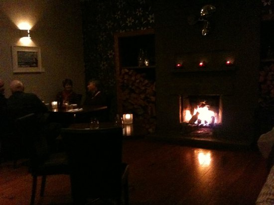 Whitianga, New Zealand: A Warm Glow of a Log Fire for dining on a cold winters night
