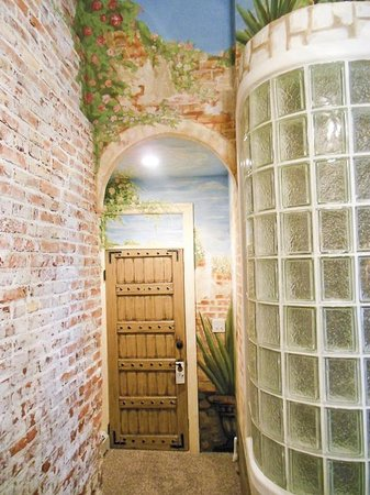 The Mission Inn: San Francisco de Asis entry foyer and curved bathroom wall