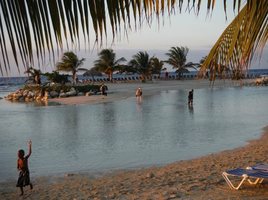 Holiday Inn SunSpree Resort Montego Bay: Walking through the shallows to the little island