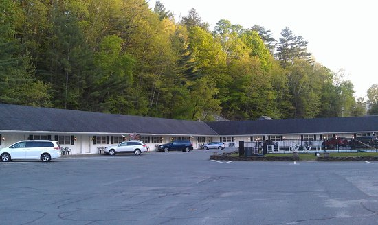 Saint Johnsbury, VT: View from the parking lot near sunset. Edge of pool on the right.