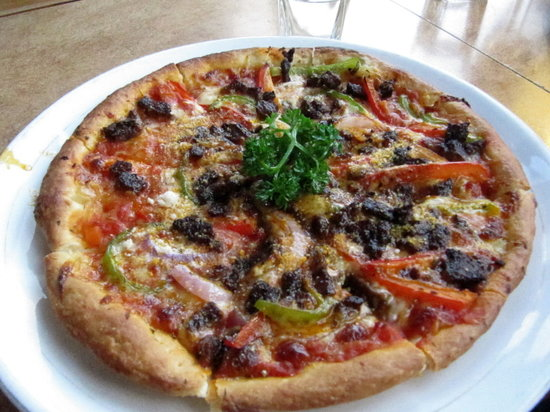 ‪‪Nanning‬, الصين: Beef pizza with peppers and onions‬