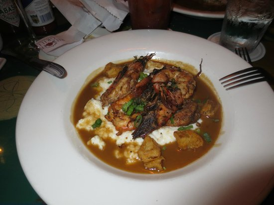 Red Fish Grill Photo: Crawfish over cheesy grits in gravy