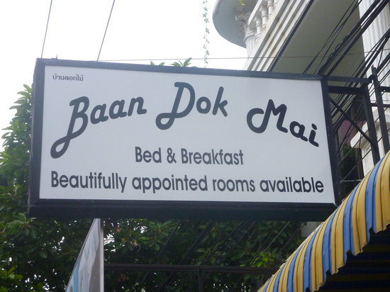 The Baan Dok Mai sign above the entrance to the downstairs cafe