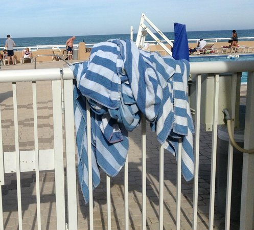 Holiday Inn Hotel & Suites Daytona Beach: Towels Put on the Fence By A Guest (Towels Stayed There For Hours)