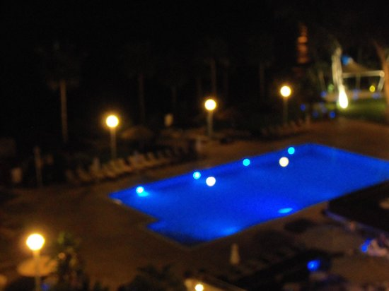 ‪‪Atlantica Miramare Beach‬: Hotel pool by night from our room balcony.‬