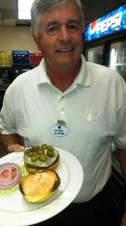 Miami Lakes, FL: Dr. Dave, director of sports entertainment snatches a Heat Burger in the Shula's 2 kitchen