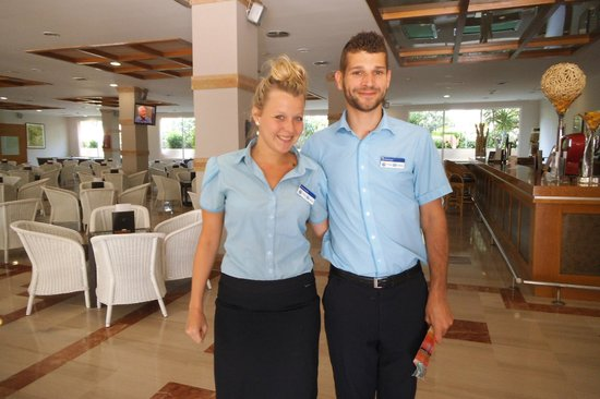 H10 Mediterranean Village: Thomas Cook Reps Emma and Carl in bar area for welcome meeting