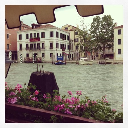 Hotel Canal Grande: View of the hotel from a restaurant across the Grand Canal