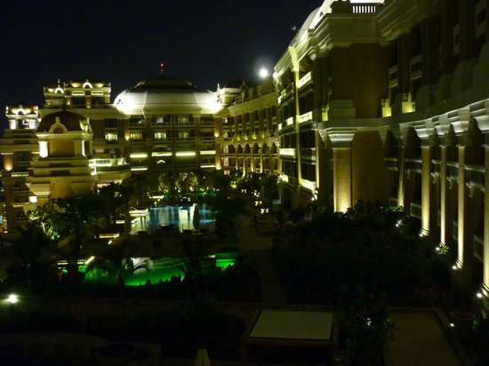 View of the pool at night picture of itc grand chola Itc grand chola chennai swimming pool