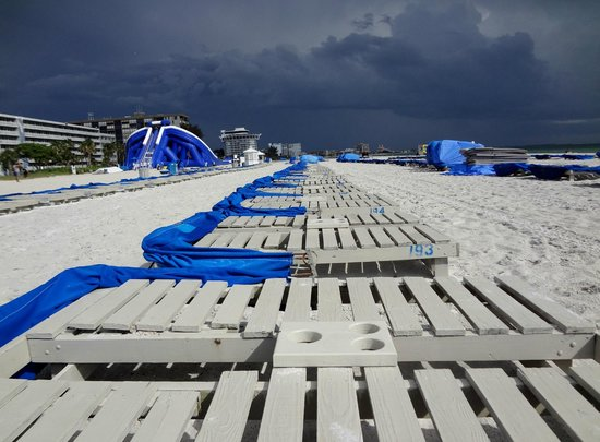 TradeWinds Island Grand Beach Resort: The beach is empty after rain.