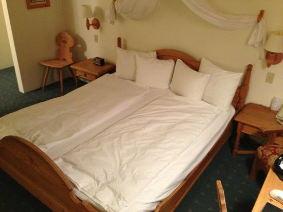 Hotel Pension Anna : The bed with duvets folded on top