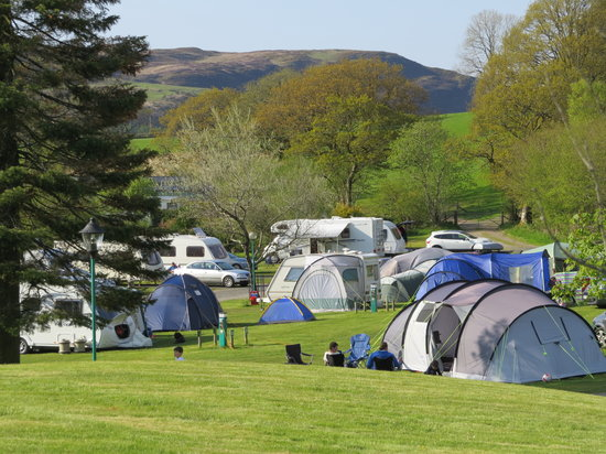 ‪The Woodlands Caravan Park‬