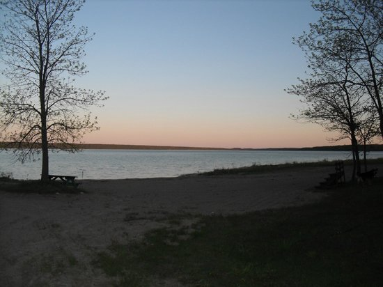 Gore Bay, Canada: A beautiful sunset view from the harbor, can be seen from the shoreline behind many of the cabin