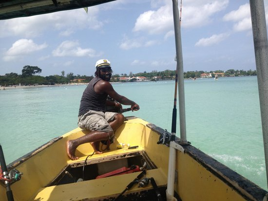 "Couples Negril: Henry the fisherman!  Can't miss him - his boat says ""Henry"" handwritten right on it!  Great fis"
