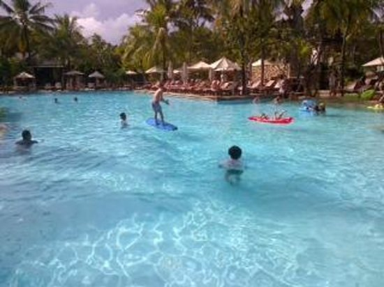 "Padma Resort Bali at Legian: vVew of Main pool with ""surfing"" activity being run by kids club"