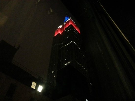 Comfort Inn Manhattan: Empire State Building's Colors viewable from the room--Red White and Blue for Memorial Day