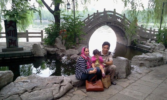 Jinan, Cina: My self, my wife and my little baby fatima next to small traditional bridge