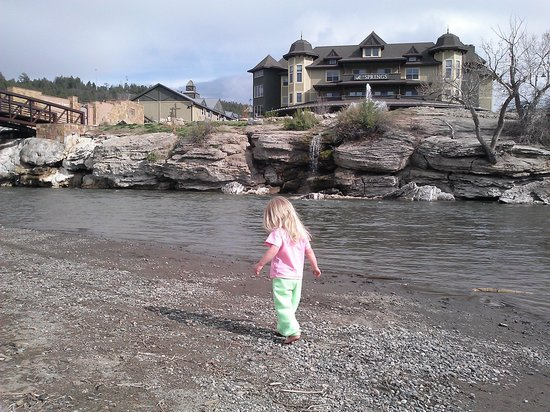 Pagosa Springs, CO : Our oldest walking along the river.  The hotel is in the background, though it's not the tallest