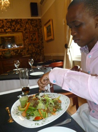 Pietermaritzburg, south africa: a colleague enjoying his manly meal