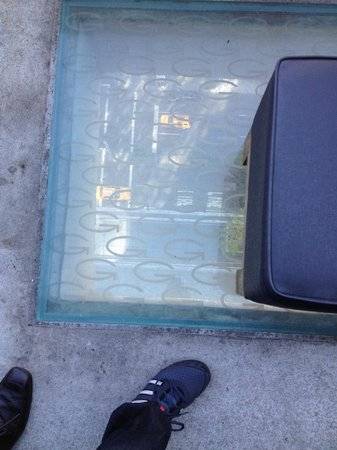 Gansevoort Park Avenue NYC: Translucent tiles on rooftop bar. Taxis are clearly seen.