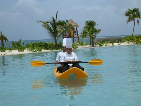 Secrets Maroma Beach Riviera Cancun: They actually bring you food in Kayaks - superb idea!