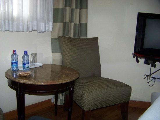 Addis Regency Hotel: table and chair in room (flat screen tv to the right but no photo)