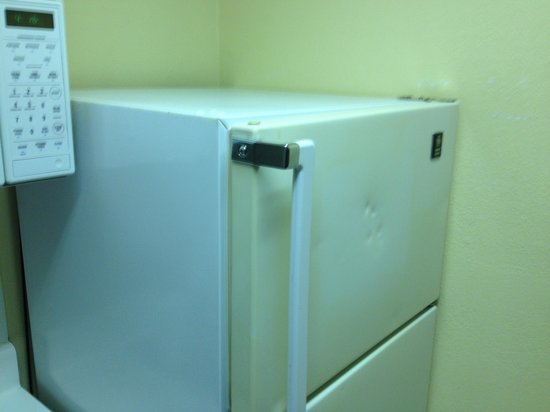 Extended Stay America - Washington, D.C. - Chantilly: Two-tone, dented fridge doors