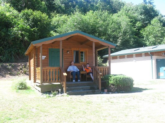 There are 8 cute little camping cabins the picnic table for Chetco river resort cabins brookings oregon