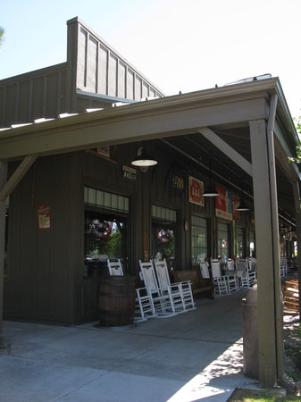 Cracker barrel front porch with chairs to relax on or buy for How did cracker barrel get its name