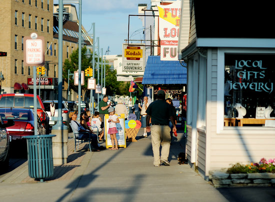 Sault Ste. Marie, MI: Portage Avenue (across from the Soo Locks) as the sun sets on downtown shoppers.